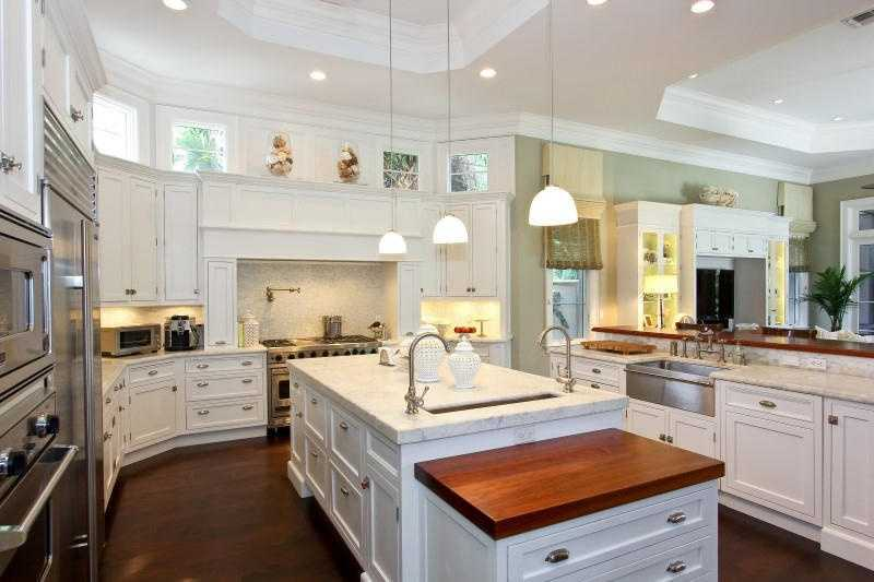 The kitchen features a beautiful island, modern appliances, and a farm sink!