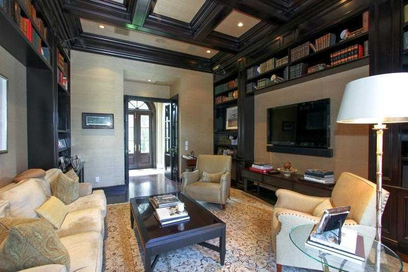 Retreat to this sophisticated entertainment room.