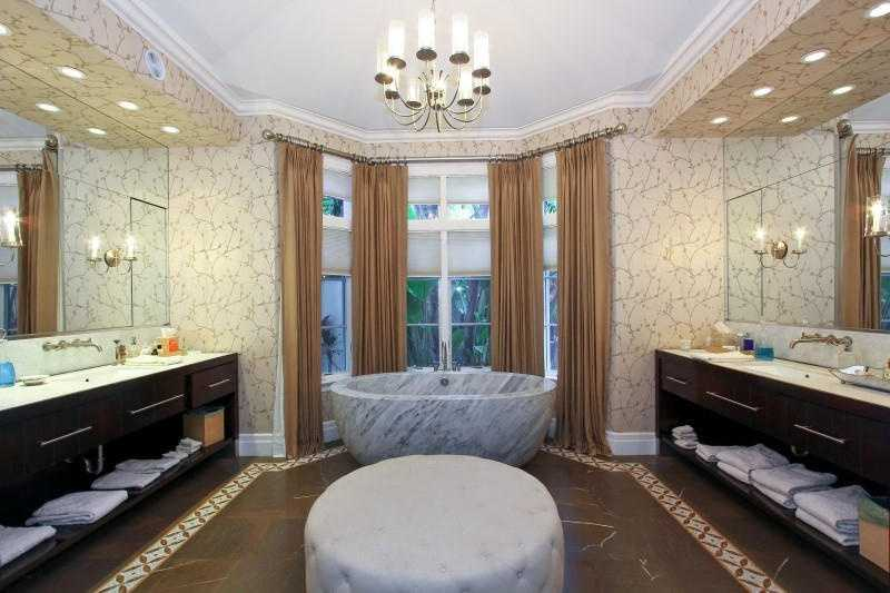 The master bathroom features a gorgeous free-standing marble tub.