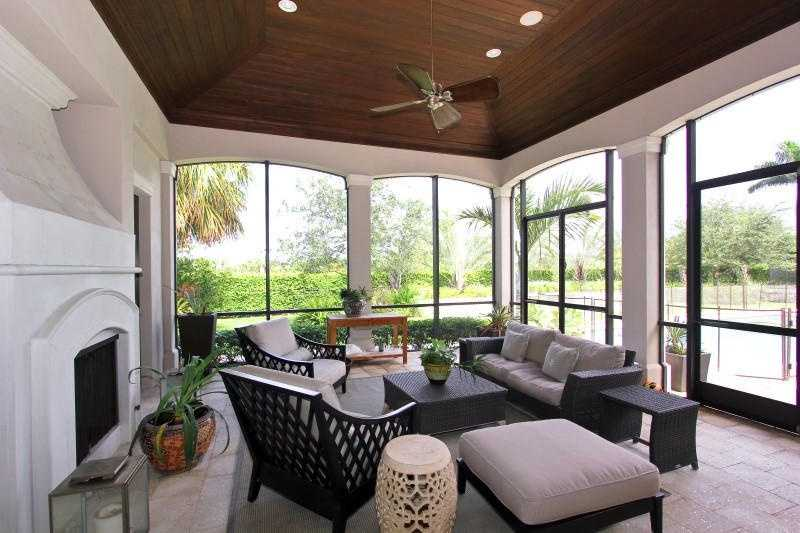 Lavish, enclosed patio space with a custom fireplace.