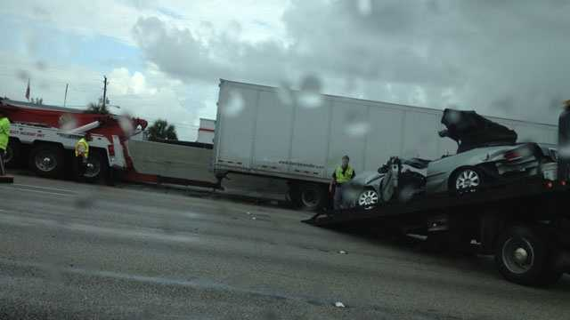 A car is towed from the scene after a fatal crash in the northbound lanes of Interstate 95 in Lake Worth.