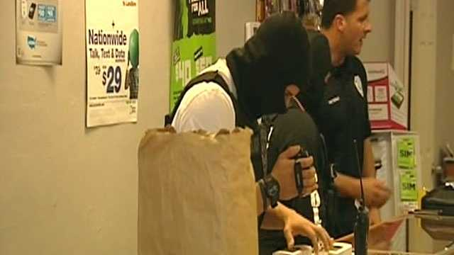 Officers raided a West Palm Beach electronics store Tuesday after they got a tip that workers there were buying and selling stolen goods.