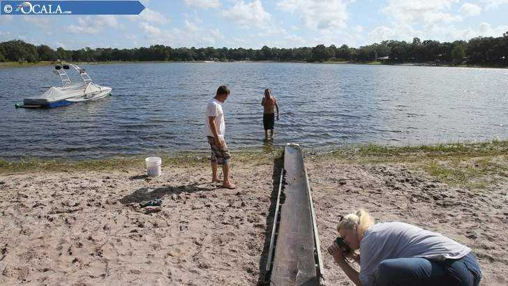 A 7-year-old boy and his grandfather found this canoe in an Ocala lake recently, and it's possible it might be several hundred years old. (Photo: Ocala Star-Banner)