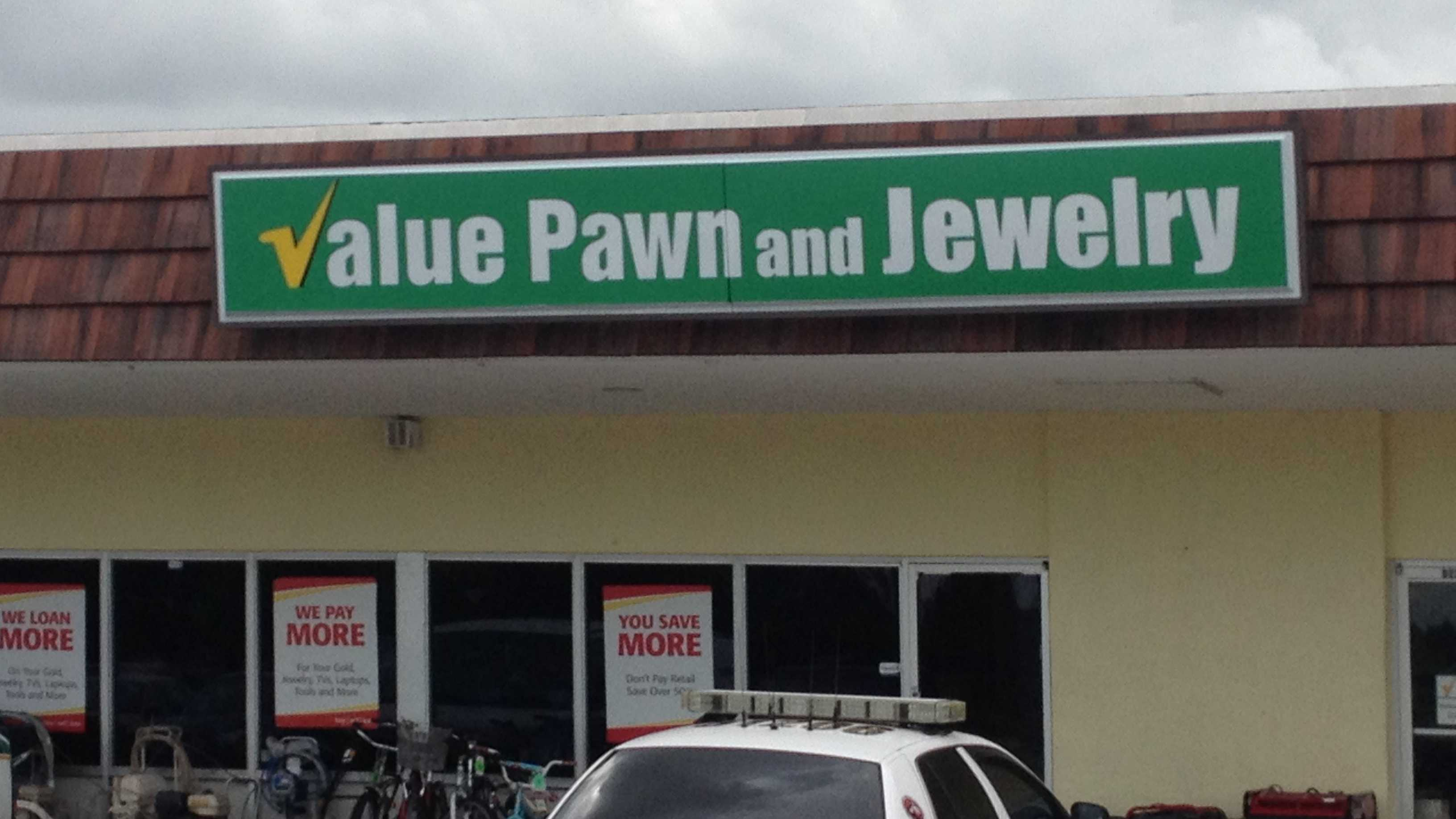 Three men are at large after robbing this pawn shop in Lake Worth on Monday morning.