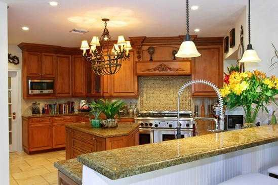 Custom cherry-wood cabinetry is featured in the kitchen.