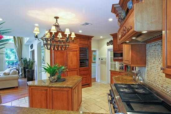 A beautiful kitchen features a spacious kitchen island.