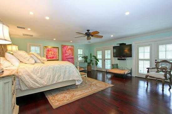 This gorgeous master showcases the home's classic Florida style.