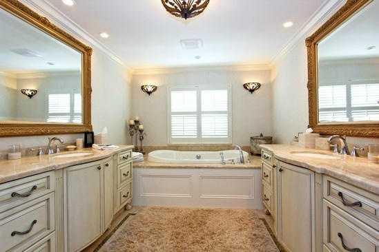 Individual vanity sinks in the master bathroom.