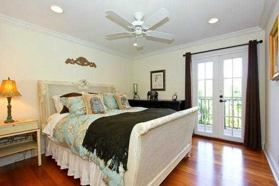 This room has it's own private balcony and hardwood floors.