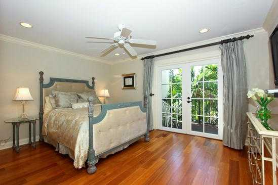 This similar guest suite is the third bedroom shown in this home.