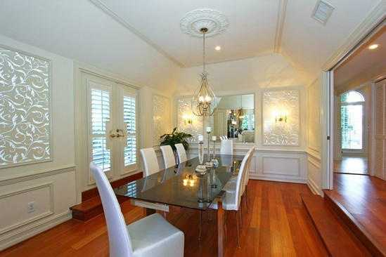 View of petite Tuscany garden, plantation shutters and wood floors for those intimate dinners with friends.