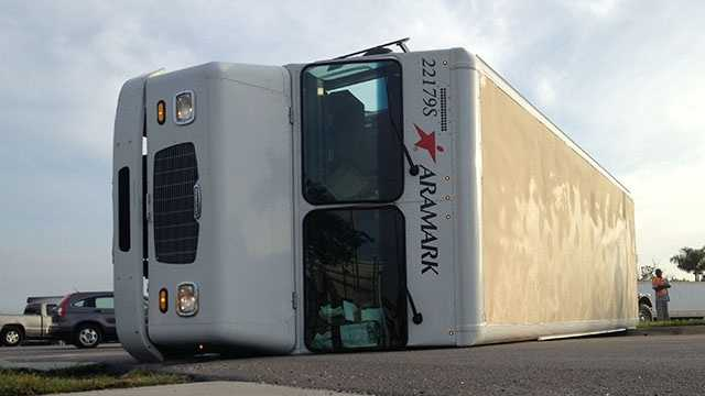 This Aramark truck landed on its side after a crash on Blue Heron Boulevard during the Wednesday morning commute.