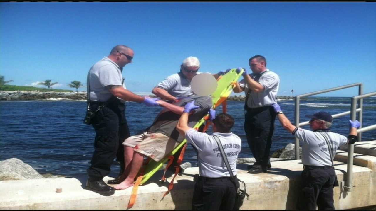 img-Man comes to rescue of guy who fell on rocks