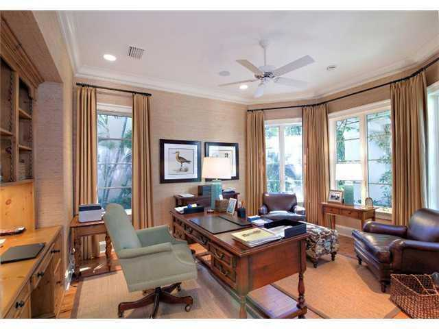 Formal office featuring a custom wooden desk.