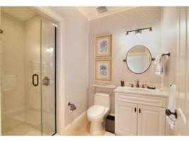 The bathroom features a spacious stand-in shower.