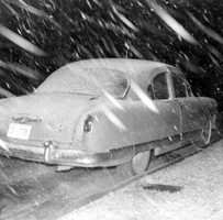 A snow covered car in Tallahassee, Florida.  Photograph taken in 1958.