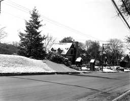 Snow alongside a sidewalk in a Tallahassee neighborhood.  Photograph taken in 1958.