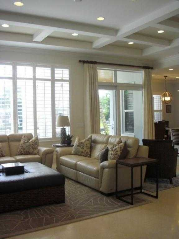 An alternate view of the living room, which is featured in the first floor's open layout.