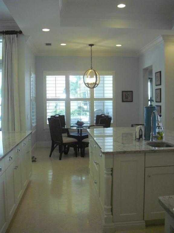 The breakfast nook looks out onto the front yard.