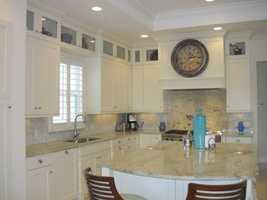 The kitchen features a very large cooking island.