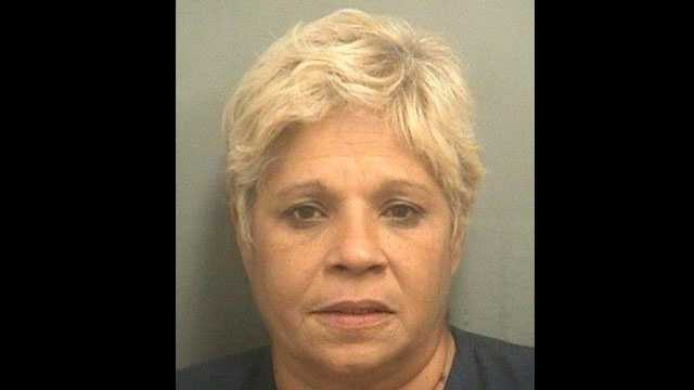 Carmen Baez is accused of taking a 14-year-old girl shoplifting at the Sears at the Boynton Beach Mall.