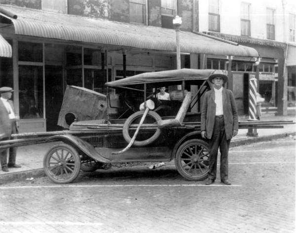 1922: A car hauls away a confiscated still.