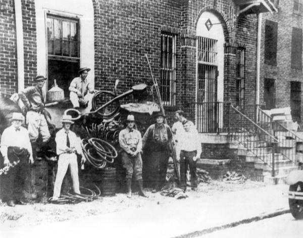 1940: Sheriffs pose with a still.