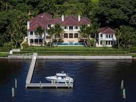 From the front of the lawn to the edge of the yacht dock, this mansion is perfection. Start your online tour now.