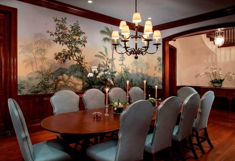 The formal dining room can seat an impressive 10 people and features vintage Old Florida decor.