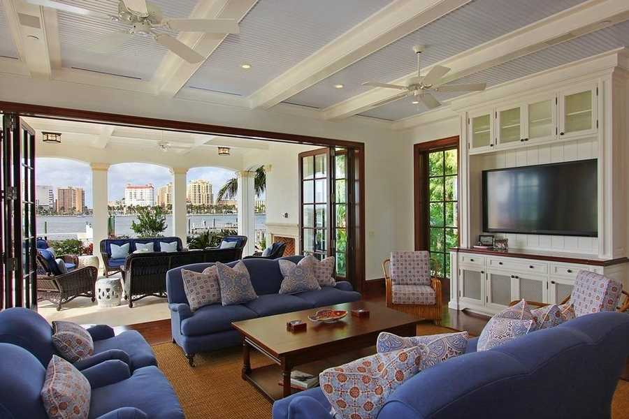 French doors give people who are relaxing in the family room, the option to relax outdoors by the water as well.