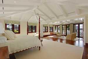 Mahogany bedroom doors,open up to a spectacular master bedroom suite.