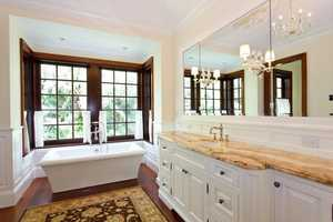 Master bathroom features a romantic stand-free tub.
