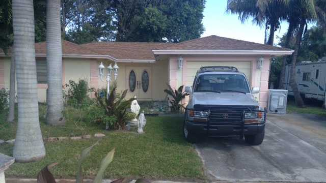 A woman was wounded by a stray bullet at this home on Lilac Circle in Lake Worth.