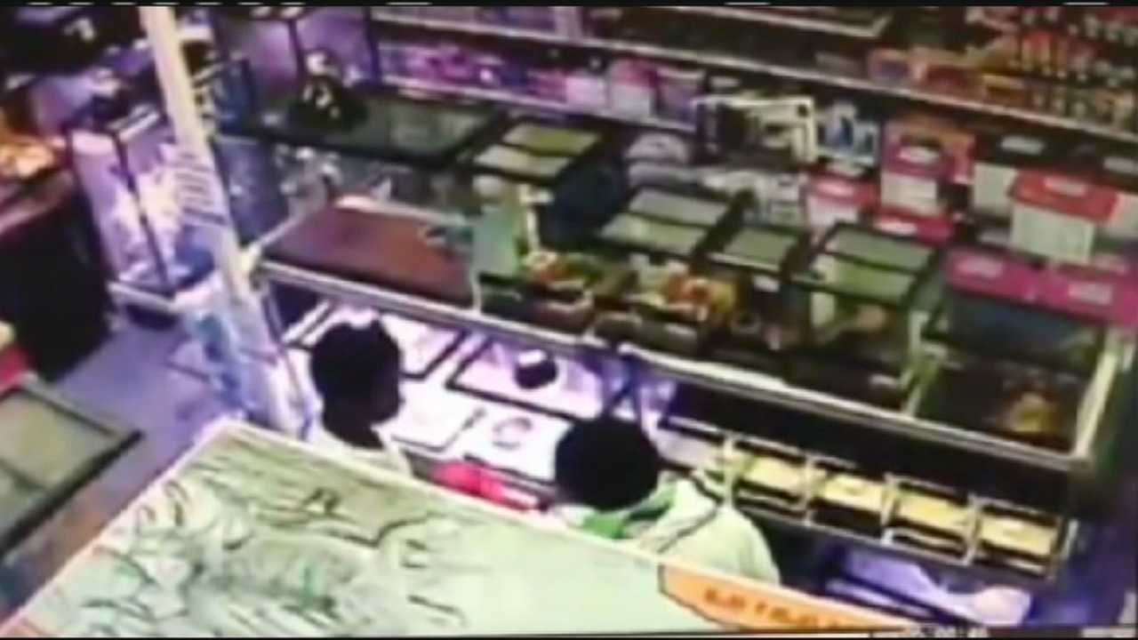 Surveillance video shows two men stealing snakes from a Bradenton pet store by stuffing them inside a hoodie.