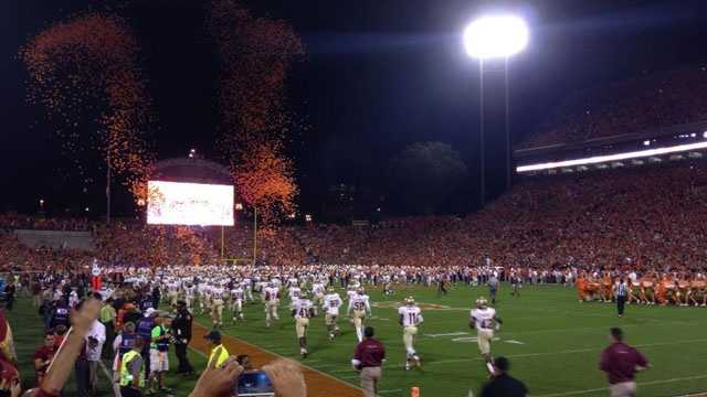 "The Florida State Seminoles take the field at Clemson's ""Death Valley"" before their 51-14 victory."