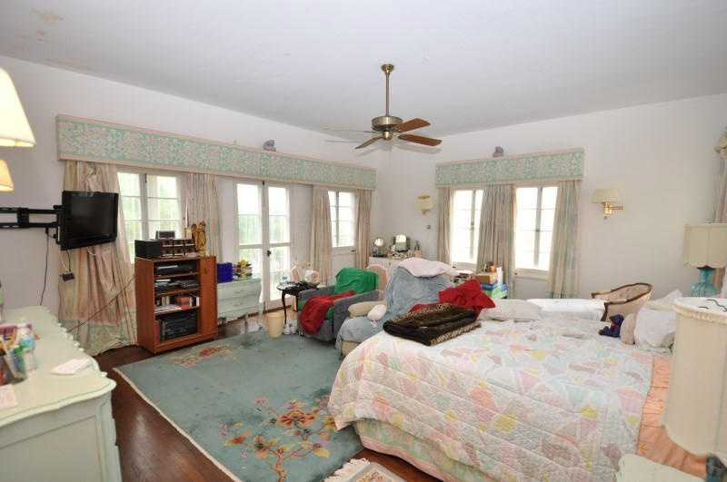 Upstairs boasts four large bedrooms.