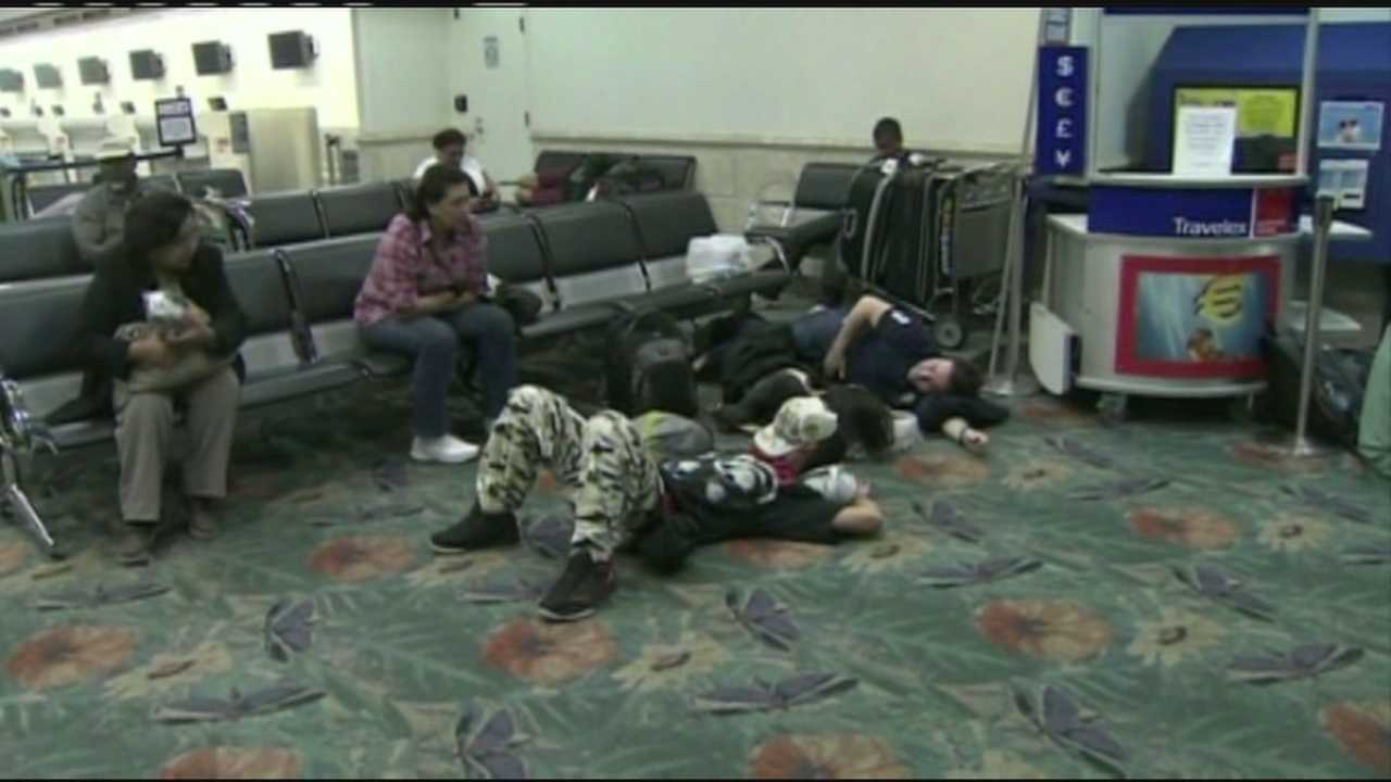 Spirit Airlines passengers pass the time at Fort Lauderdale-Hollywood International Airport because of lengthy flight delays.