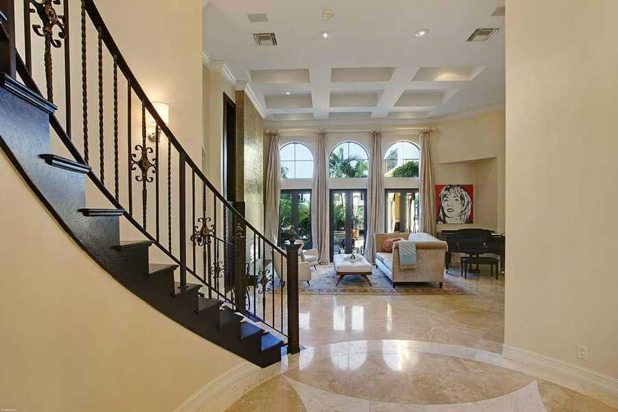 The beautiful foyer opens out to the living room.