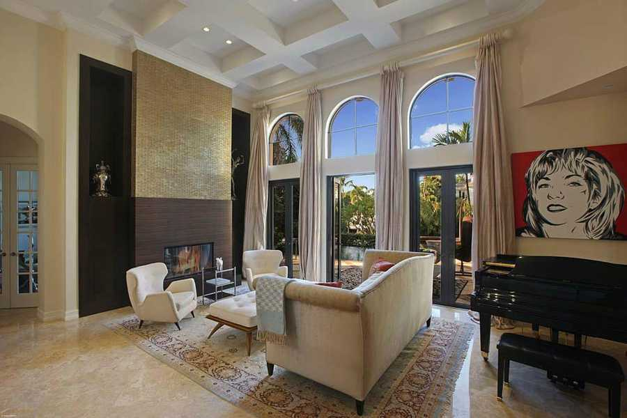 Gorgeous fireplace and hurricane impact, floor-to-ceiling windows.