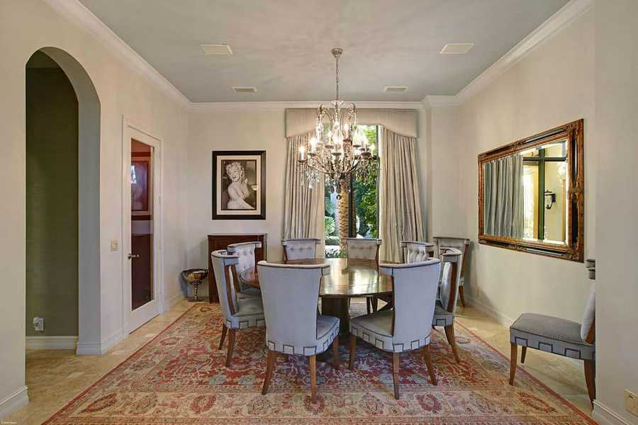 From the chandelier to the antique rug, this room is very formal.