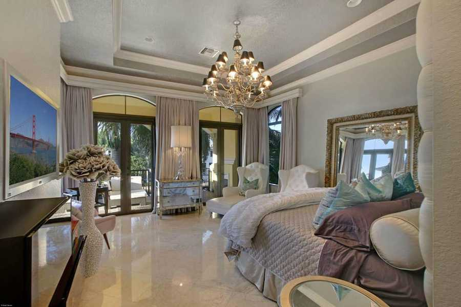 Breathtaking design from the molded ceilings, to the chandelier to the marble floor. It's your personal palace.