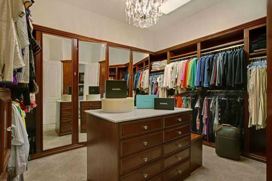 Custom cabinetry in this walk-in closet.