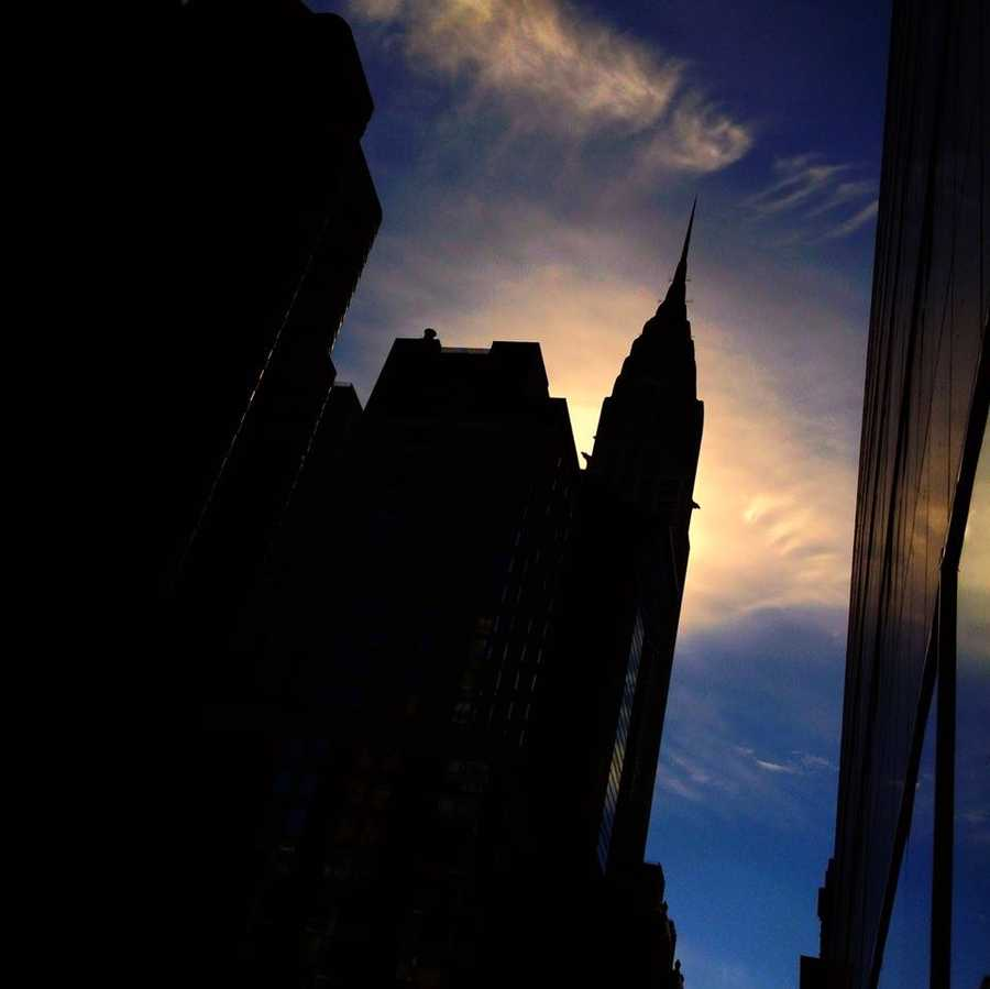 I like shooting shadows and silhouettes. Here's the Chrysler building with the sun behind it.