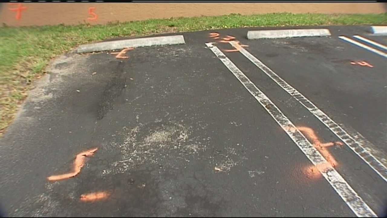 Benjamin Gray's body was found inside a burned car in this parking space at a West Palm Beach apartment complex.