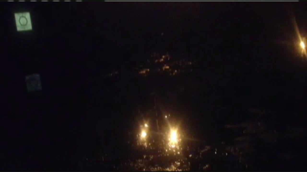 Body in canal night scene