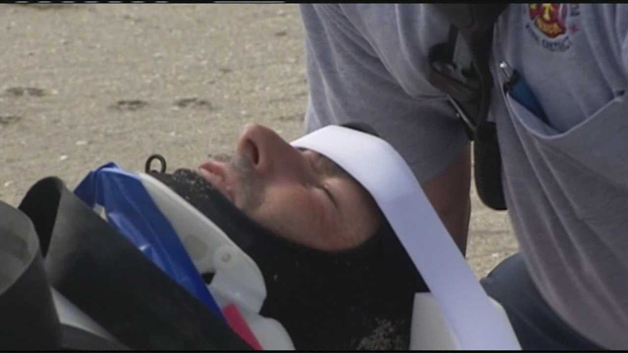 A surfer injures his neck during the rough surf in Fort Pierce and leaves the beach on a stretcher.