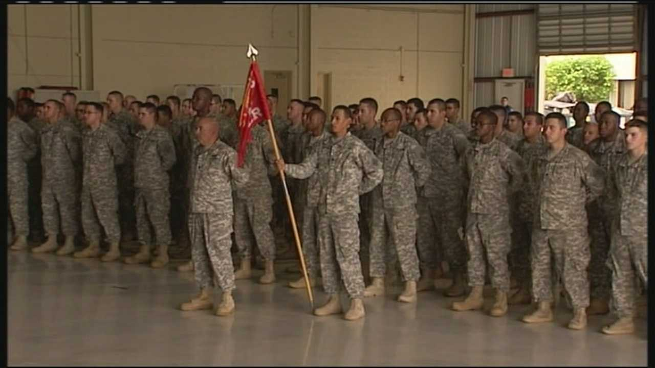 Family members say goodbye to their loved ones who are preparing to leave for Afghanistan.