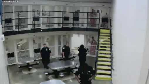 This surveillance video shows an Indian River County Sheriff's Office deputy using pepper spray on an inmate at the jail.