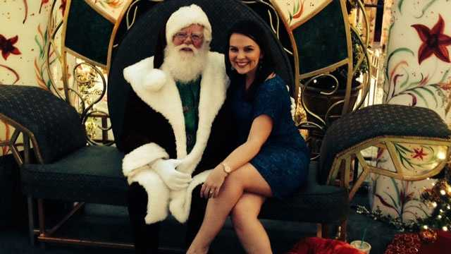 WPBF 25 News' Stephanie Berzinski poses with Santa Claus at the Gardens Mall.