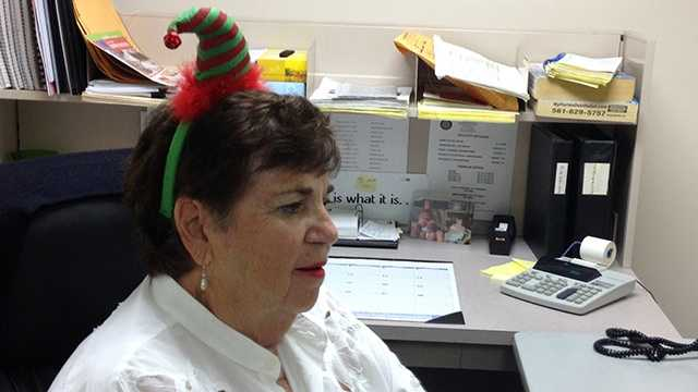 Office drone wearing Christmas hat